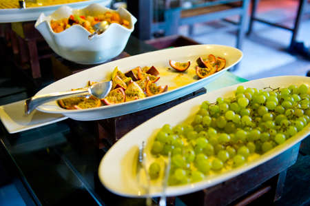 Delicious hotel restaurant allinclusive buffet with tasty food. Fruit papaya, pineapple