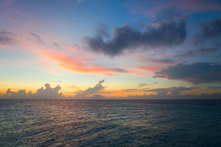 Fantastic sunset sky and ocean at warm summer evening