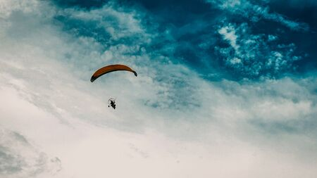 Playing paragliding on the beach when the weather is sunny