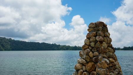 View of the Hindu Temple building by the lake
