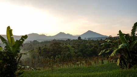 The view of the sun rising behind the mountain