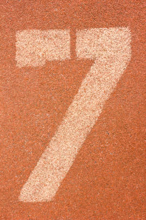 number seven on running track photo