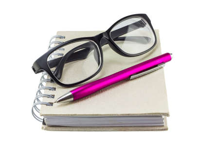 notebook , pen and eyeglass on white background photo