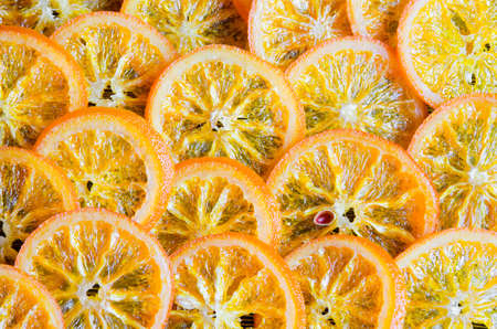 candied: Sliced candied oranges background Stock Photo