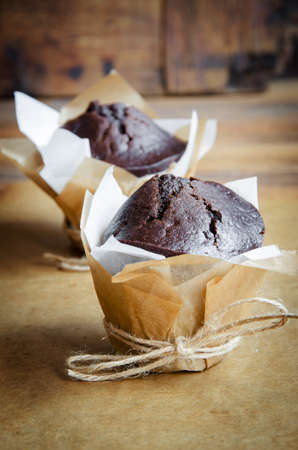 gift wrapping: Two chocolate muffins in gift wrapping