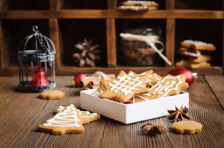 gingery: Christmas cookies and decoration on wooden table Stock Photo