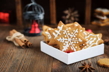 Christmas cookies and decoration on wooden table Stock Photo