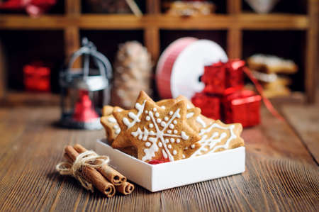 Christmas cookies with decorations, cones, gift on wooden background Stock Photo