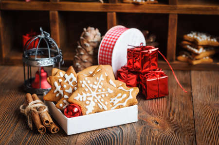 Christmas biscuits with decorations, cones on a wooden background