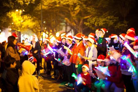 Hong Kong, China - December 24, 2010: Christmas carolers at Nathan road, a group of musician playing christmas songs at night