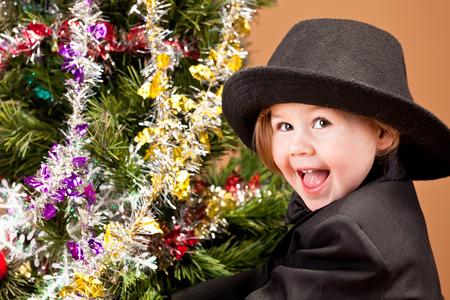 Little Boy Decorating Christmas Tree. photo