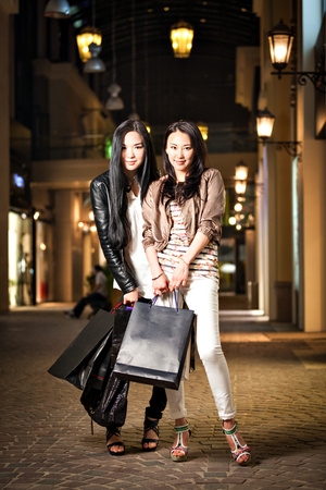 pakistani ethnicity: Two young asian woman shopping.
