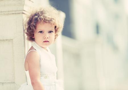 Little girl in wedding dress. photo