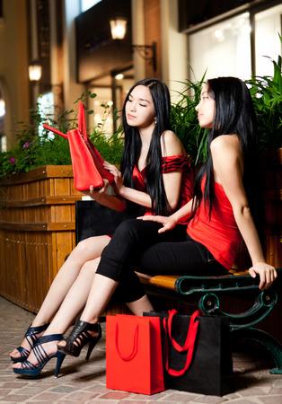 pakistani ethnicity: Two young woman shopping Stock Photo