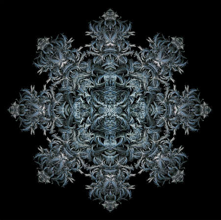 Composite of intricately filigreed blue and silver ice crystals photographed on a window, shaped into an octagonal snowflake design on a black background.