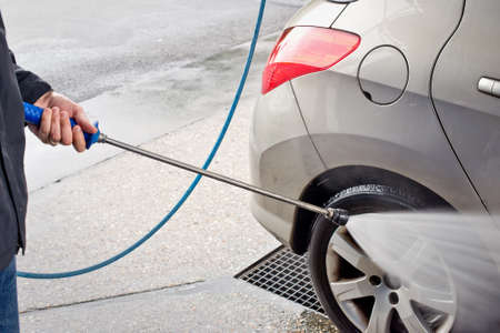 water jet: Car washing with a high pressure water jet Stock Photo