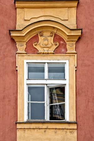 pediment: Classical colorful window with pediment in Prague, Czech Republic Stock Photo
