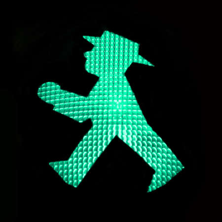 Green pedestrian traffic light with the Ampelmann of East Germany, Berlin