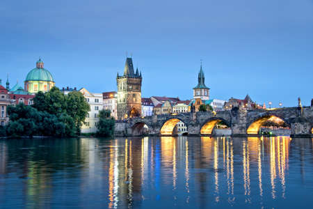 Vltava river and Charles bridge by night, Prague, Czech republic photo
