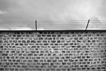 prison fence: Wall and barbwire black and white Stock Photo