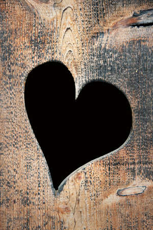 Wooden plank background with a heart shape photo