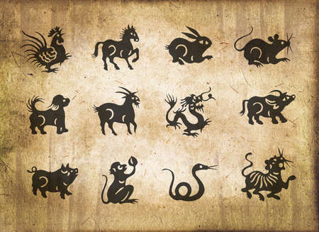 Animal of the chinese zodiac, sepia textured paper  photo