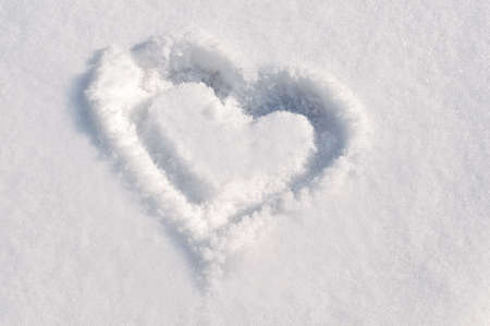 Drawing of a heart in the snow photo