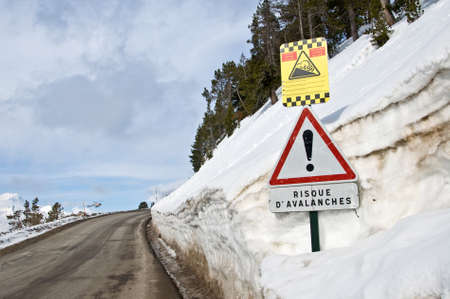 avalanche: French avalanche danger sign on the side of a snowy road