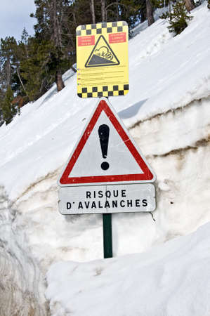 French avalanche danger sign on the side of a snowy road photo
