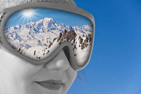 ski mask: Close up of a girl with a ski mask and reflection of the Mont Blanc Stock Photo