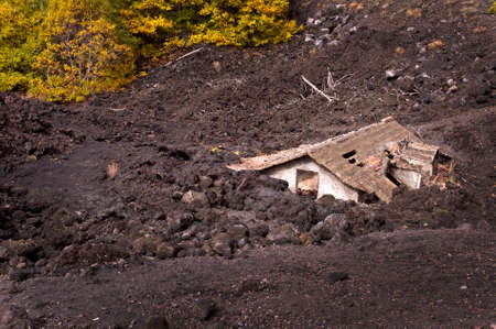 etna: Roof of a house covered by lava of Etna volcano, Sicily, Italy