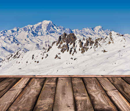 Wooden deck with a view on the Mont-Blanc in winter photo