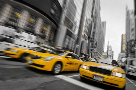 busy street: Yellow taxis in the streets of Manhattan, New York, USA