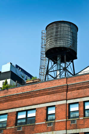 Water tank on the top of a building, New York City, USA