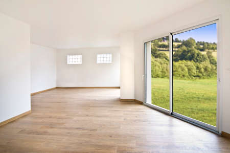 big windows: Empty modern house interior, countryside view