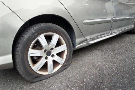 Flat rear tire on a car photo