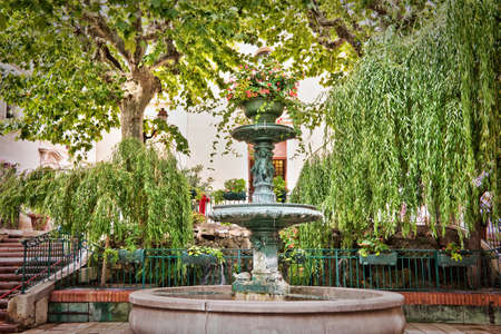 Provencal fountain, Bandol, French riviera, France photo