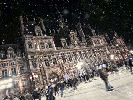 townhall: Blurred people on the skating rink in front of the Hotel de Ville (townhall) of Paris, France