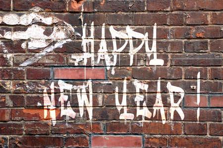 Happy new Year on a brick wall, street-art style photo