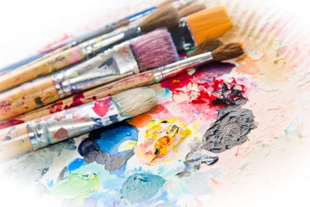 painter palette: Used paint brushes on a colorful painter palette