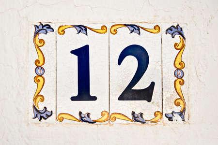 number 12: Ceramic tile, street number 12