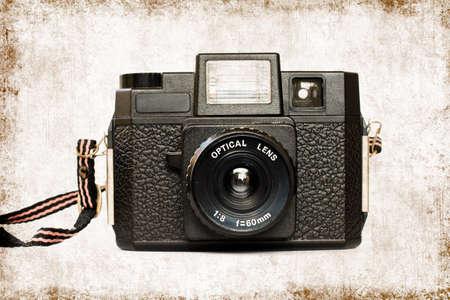 lomography: Vintage lomography camera, textured background