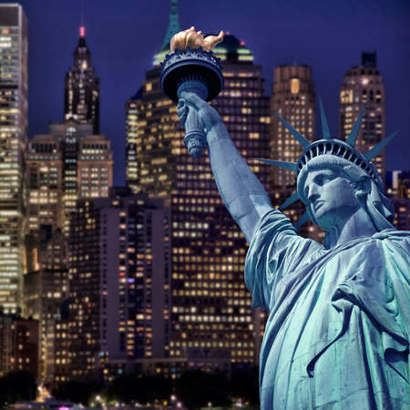 Statue of liberty by night, New York skyline background photo