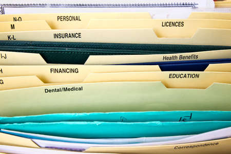 Close up of domestic personal files in expanding pocket folders photo