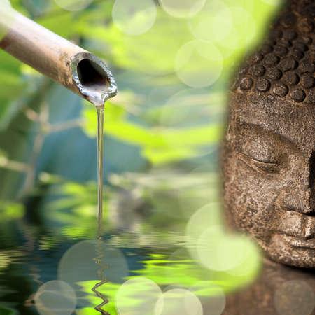 bamboo fountain: Buddha and bamboo fountain Stock Photo