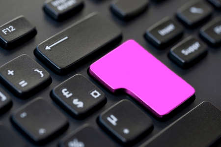 negative returns: Close up of a pink blank return key on a black computer keyboard Stock Photo