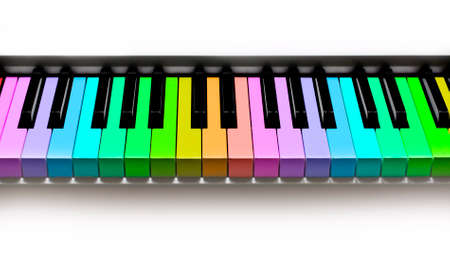 Rainbow piano keyboard, isolated on white background photo
