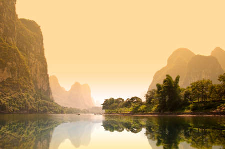 rivers mountains: The river Li (lijang) at sunset between Guilin and Yangshuo, Guangxi, China Stock Photo