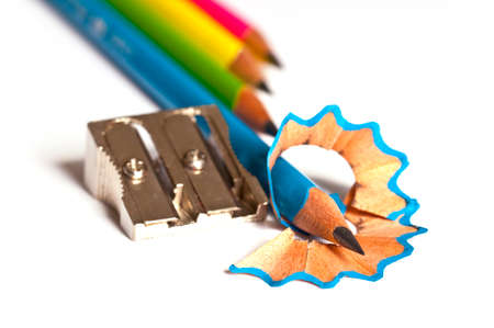 Wood pencils and pencil sharpener on white background