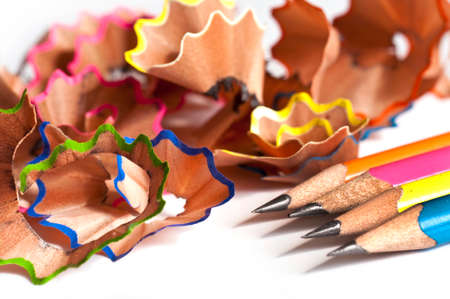 Colorful wood pencils shavings on white background